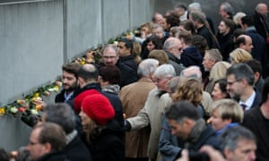 People attend a memorial activity to commemorate the 25th anniversary of the fall of the Berlin Wall.