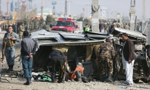 Afghan security forces inspect a British embassy vehicle which was targeted in a suicide attack in Kabul.