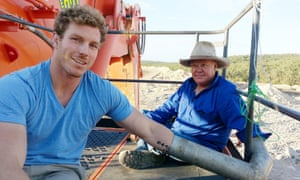 The former Wallabies captain David Pocock, left, locked onto a digger at the Maules Creek mine in New South Wales.