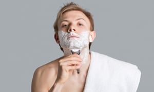 A young man, probably using a man's razor