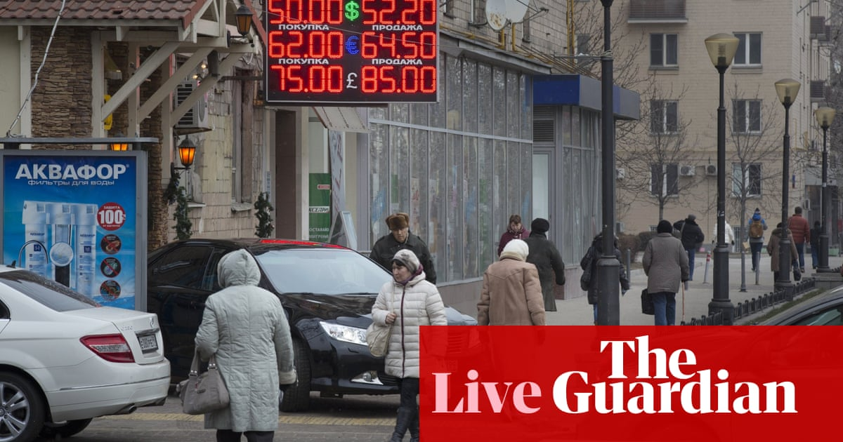 Ruble tumbles after oil hits five-year low, before recovering