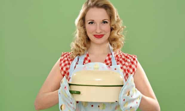 Woman holding casserole dish