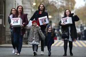 Russell Brand joins residents and supporters from the New Era housing estate in East London as they deliver a petition to 10 Downing Street.