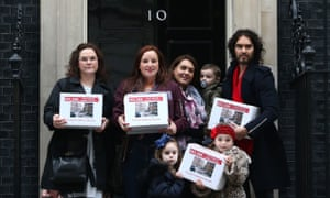Comedian Russell Brand joins residents and supporters of the estate as they deliver their petition to 10 Downing Street.