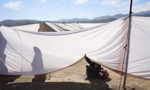 A sheet dividing boys from girls at the Norwegian Refugee Council school in Gulan refugee camp.