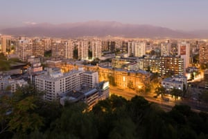 Santiago, Chile. City skyline and the Andes mountains at dusk
