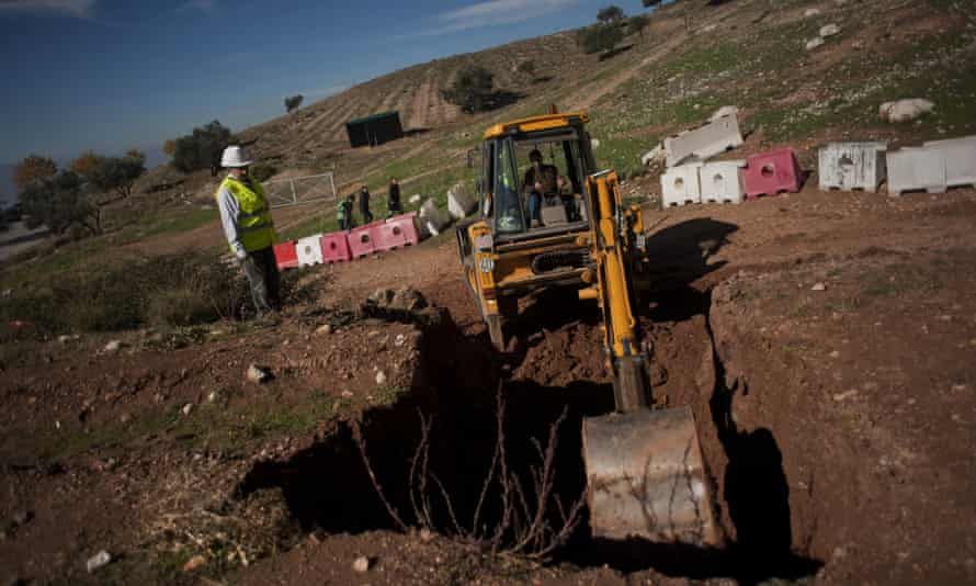 Technical staff start excavations in a park near Granada, where Federico Garcia Lorca is believed to be buried.