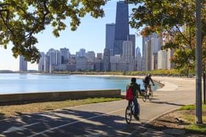 Chicago, Illinois, US. Cyclists riding along Lake Michigan shore