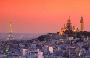 The Sacre-Coeur and Eiffel Tower above the Paris skyline at dusk