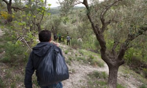 Militants walking on wooded hillside en route to the Syria-Turkey border in the Hatay province of Turkey.