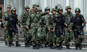 Chinese paramilitary police in Urumqi, Xinjiang, where Beijing says it is fighting a violent separatist campaign by Islamists.