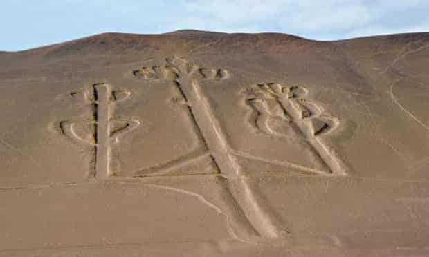 A candelabra type form drawn into the desert, in Paracas, Peru, related to the Nazca Lines in appearance.