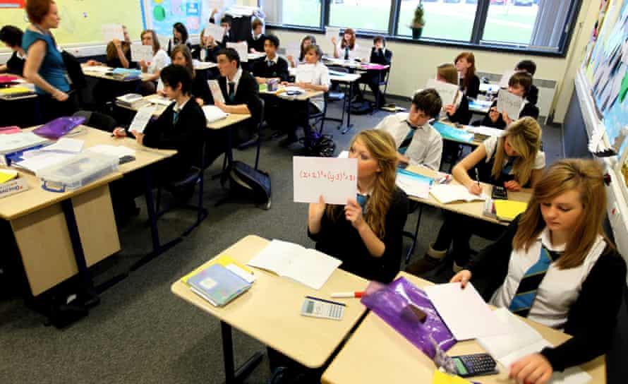Pupils at Williamwood High School attend a maths class in Glasgow, Scotland