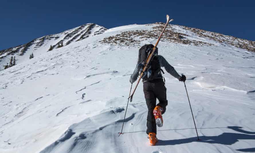 Moab, Utah, USA --- Cross country skier hiking up slope --- Image by   Whit Richardson/Image Source/Corbis30s