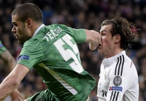 Real Madrid's Gareth Bale is punched in the nose by Ludogorets' defender Georgi Terziev during their UEFA Champions League game at the Bernabeu.