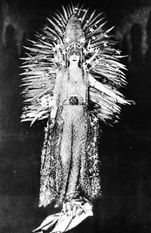 Marchesa Luisa Casati wearing a costume symbolising light to a fancy dress party in Paris, 1922. The costume, designed by Worth, is made of a net of diamonds, incorporates a gold feather sun against a diamond tiara and has a glittering silver fringe.