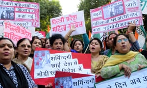 Members of the All India Women's Congress attend a protest in New Delhi to mark the increasing violence against women.
