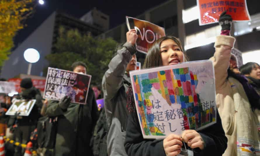 Protesters march in front of Shinzo Abe's official residence against the state secrets law.