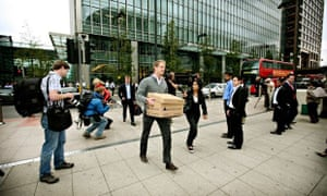 Lehman Brothers employees leaving the Canary Wharf building in London.