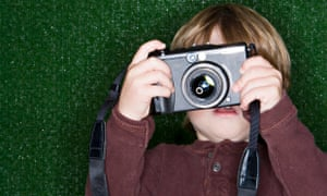 Family: Boy (2-4) taking photograph with digital camera