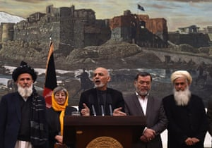 Afghan President, Ashraf Ghani (C) speaks during a press conference at the Presidential Palace in Kabul on December 10, 2014.  A