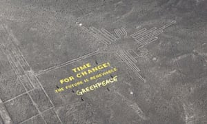 Greenpeace's 'time for change' message next to the hummingbird geoglyph in Nazca.