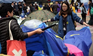 Pro-democracy protesters pack up their tents at the main protest site in the Admiralty district of Hong Kong.