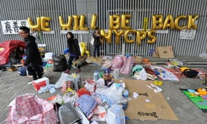Pro-democracy protesters at Occupy Central with a balloon sign saying: 'We will be back'.