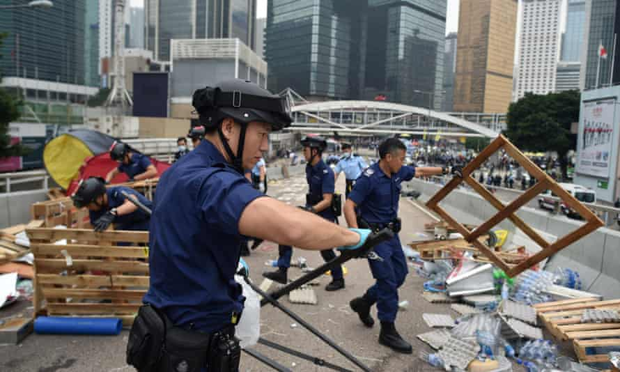 Police dismantle the remains of the protest camp in the Admiralty district.