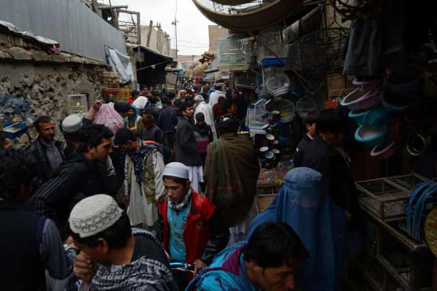 Afghan shoppers throng the Mandave market area in downtown Kabul.