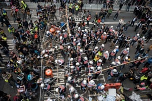 11 December Authorities dismantle a barricade set up by pro-democracy protesters. Bailiffs started dismantling barricades at Hong Kong's main protest site after more than two months of pro-democracy rallies