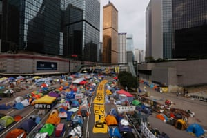 7 December Huge protest banners and tents set up by protesters block a main road outside the government headquarters at Admiralty