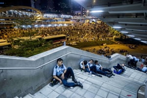 September 29 Police officers rest during pro-democracy protests during which tens of thousands of pro-democracy demonstrators brought parts of central Hong Kong to a standstill