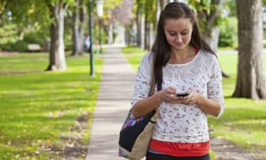 A young woman using an iPhone