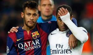 Lucas, right, is consoled by Barcelona's Neymar after Paris Saint-Germain's 3-1 defeat.