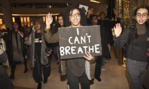 Protestors march through Westfield shopping centre in London to protest.
