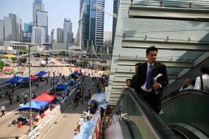 October 6 People make their way to work after protesters agreed to allow access to the central government complex in the Admiralty district