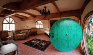 Once through the circular door in the Thai hobbit house, you'll find yourself in a rather spacious interior. It may have grass roof, but internet, air con and television are all available inside.