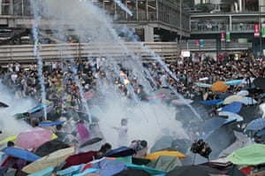 September 28 Riot police launch tear gas into the crowd as thousands of protesters surround the government headquarters in a challenge to Beijing over its decision to restrict democratic reforms for the city