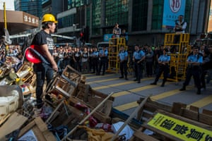 25 November A protester shouts at police from the top of a barricade after the arrival of bailiffs to dismantle the Mong Kok protest site following an eviction order