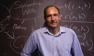Tim Berners-Lee, inventor of the World Wide Web, stands at a chalkboard where he has written notes on Web development.