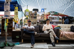 18 November People read at a road library set up by protesters in the Mong Kok district after authorities cleared part of the city's main pro-democracy camp – the first of several planned evictions to shrink the mass sit-ins that have blocked major thoroughfares for seven weeks