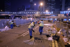 11 December Workers sweep a road after police began dismantling the city's main pro-democracy site in the Admiralty district, clearing away tents and barricades, and arresting some protesters who nevertheless vowed that their struggle lives on
