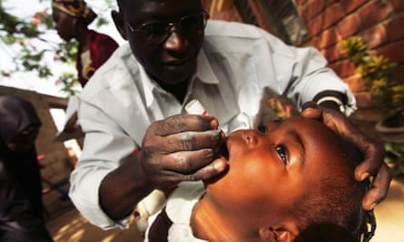 A Nigerian schoolgirl is vaccinated against polio