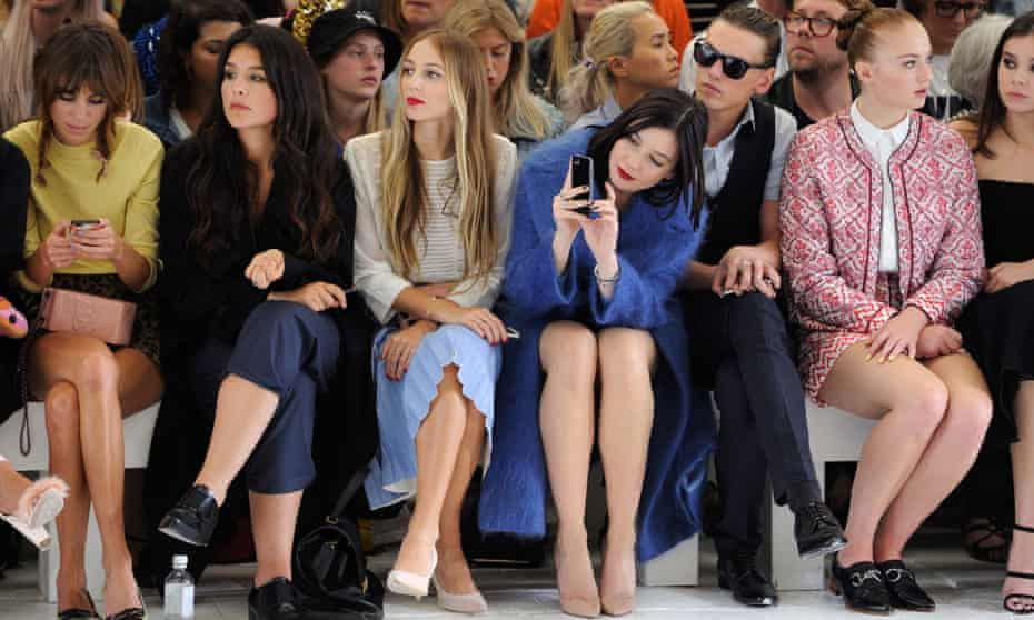Alexa Chung, Jessie Ware, Harley Viera Newton, Daisy Lowe, Jamie Campbell Bower and Sophie Turner attend the TopShop Unique show during London Fashion Week.