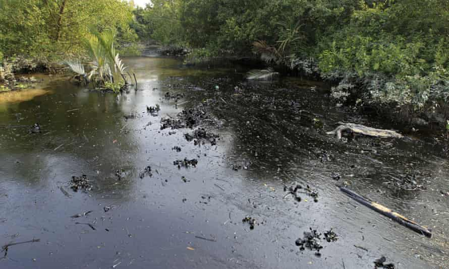 Oil from a Bangladeshi oil-tanker is seen on the Shela River in the Sundarbans in Mongla.