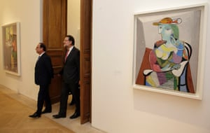 Francois Hollande (L) and Mariano Rajoy walk past the painting Portrait of Marie-Therese (1937) by Pablo Picasso at the Picasso Museum