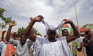 Sudanese anti-government protesters chant in the Omdurman district of Khartoum, Sudan.