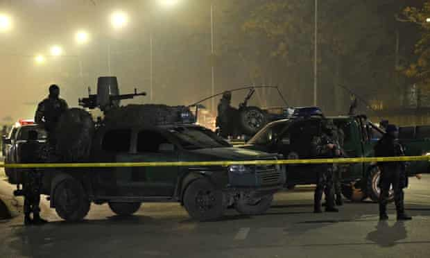 Afghan soldiers near the site where a bomber blew himself at the Istiqlal high school in Kabul