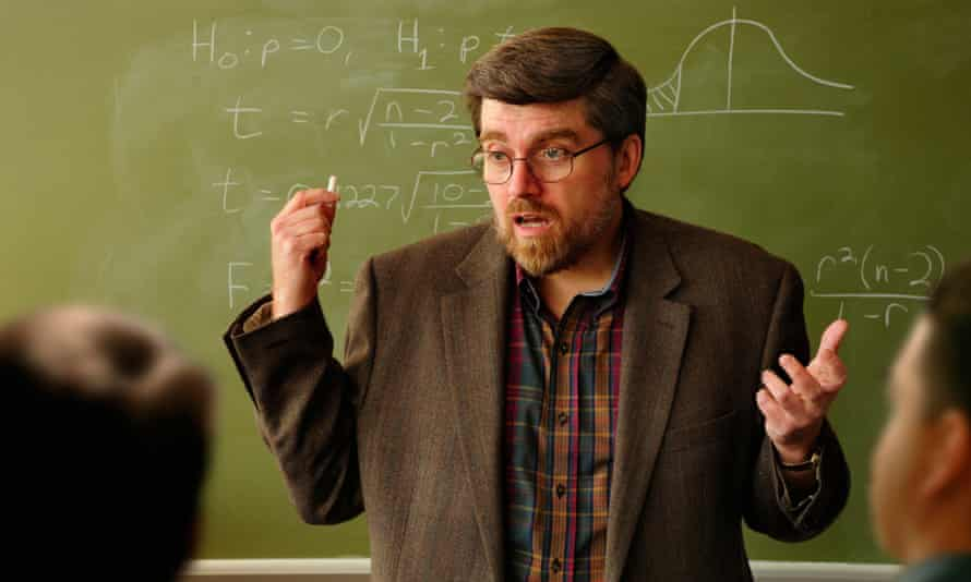 Lecturer in front of chalkboard
